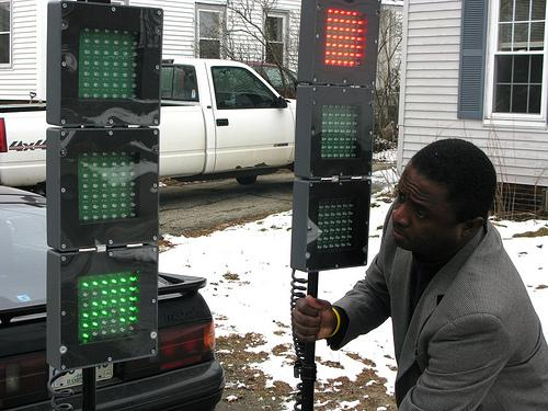 Evan Bontemps of Newmarket sets up his portable stoplight, designed to manage traffic during power outages. Bontemps' company received aid from the Green Launching Pad program.