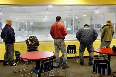 Anxious to find out if they passed the NHDMV motorcycle training course, students focus on a hockey game in play at the Tri-Town Ice Arena where the course is held.