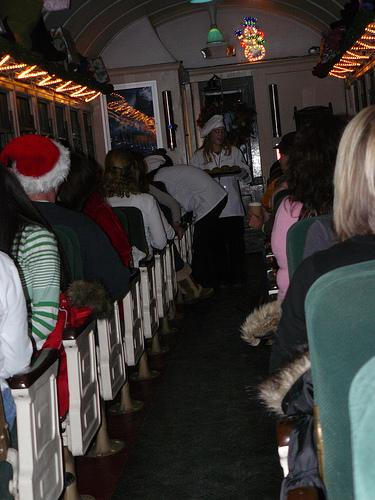 The interior of the Polar Express is compiled with Christmas decor.