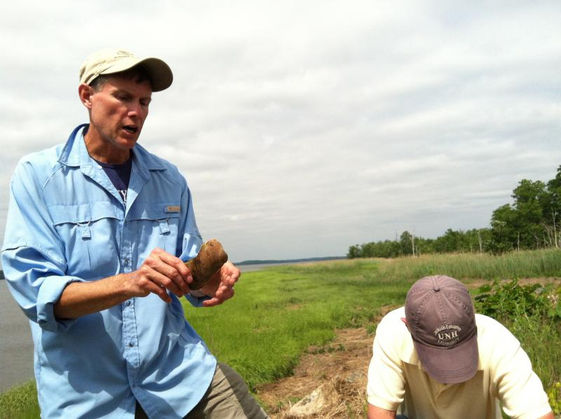 The two expert Rays, Ray Konisky (left) and Ray Grizzle, show how baby oysters, or spat, need a substrate to adhere to.
