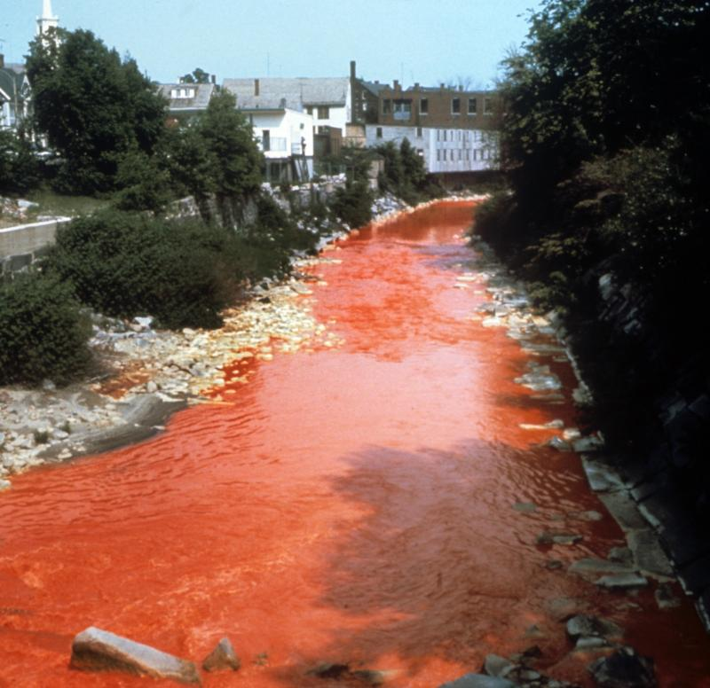 "The Nashua River ""runs red"" with paper mill dye in the 1960's, as shown in the film ""Marion Stoddart: The Work of 1000."""