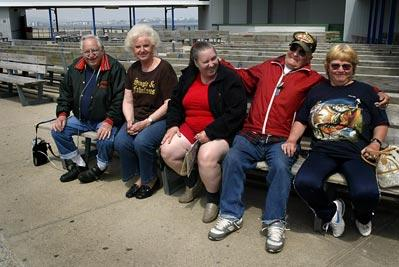 "Local seniors from Rye sit, Seabrook and Hampton people watch. Donald Flint, and his fifth wife Sandy are far right Donald is the dancer in the group Patricia Frazier, second from left, could ""Own half the bench she sit's on with the taxes she pays"""