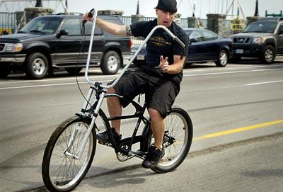 An unidentified male cruises the RTE1a Hampton Beach strip on his modified bike.