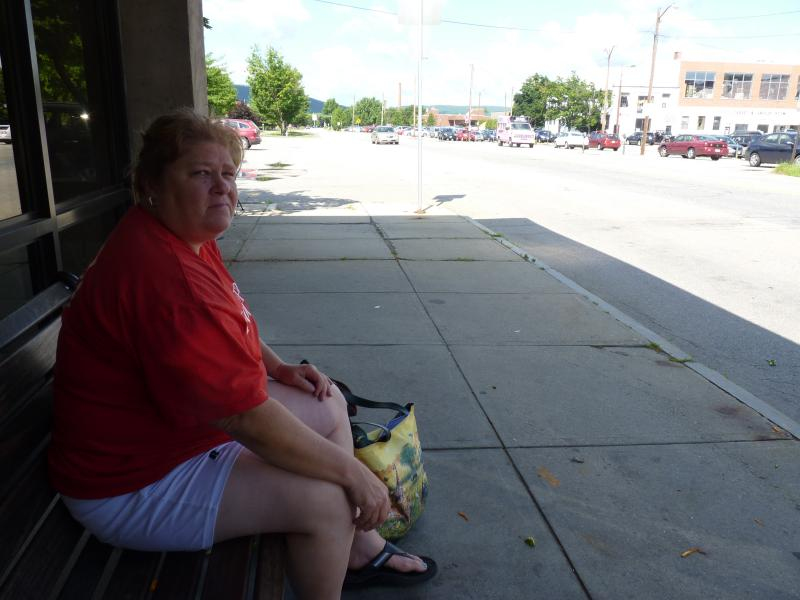 Susan VonStade waits for the Greyhound bus in Keene.