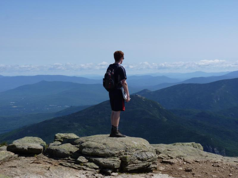 Seth Bishop, Greenleaf's resident naturalist, surveys the scene from atop Mt. Lafayette.