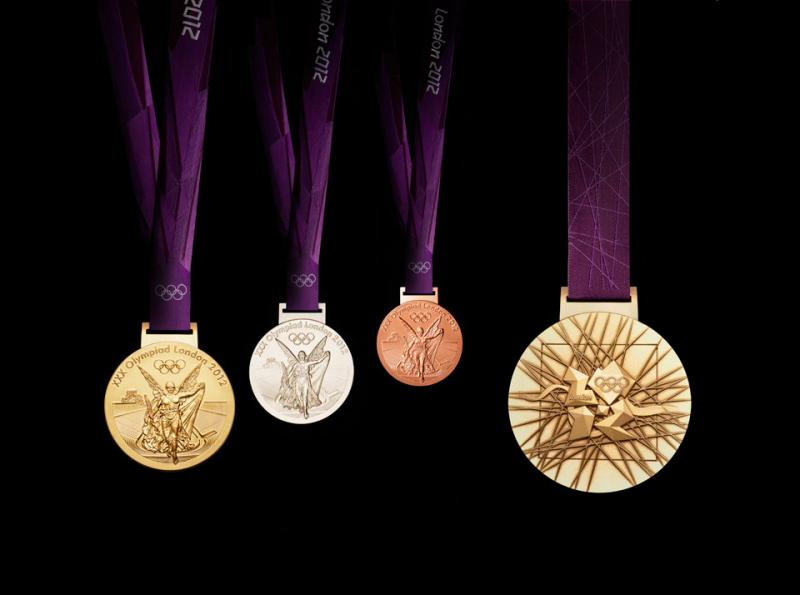 London 2012 Olympic medals designed by British artist David Watkins. The Olympic medals disk circular form is a metaphor for the world.