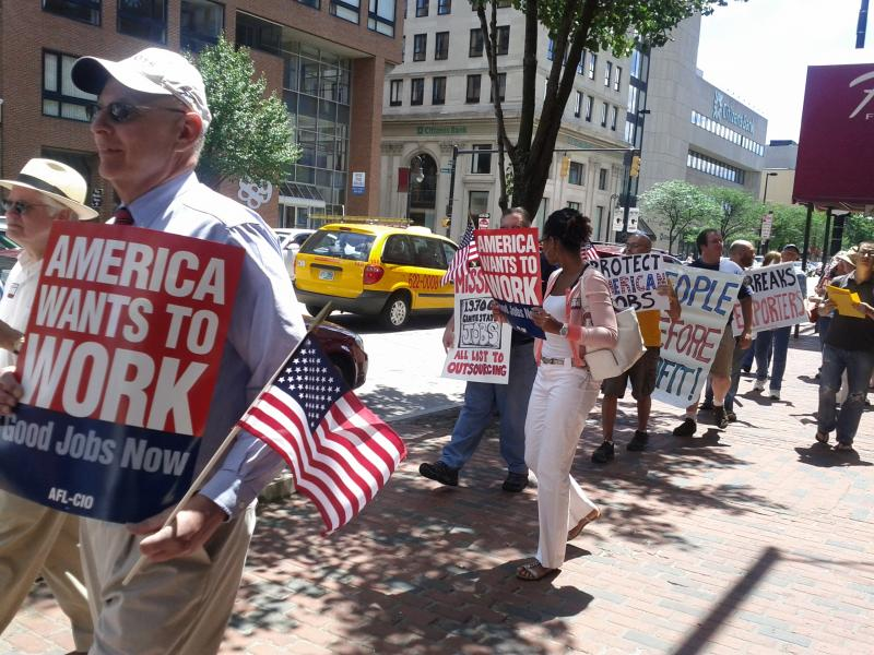NH AFL-CIO President Mark MacKenzie leading the march down Elm St. in Manchester.