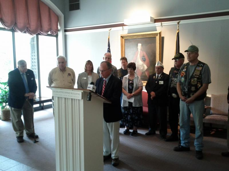 Congressman Charlie Bass flanked by various veterans groups.
