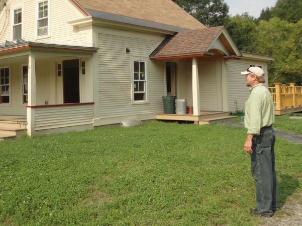 Irene construction analyst Peter Edlund oversees the statewide effort to rebuild homes damaged by Irene.