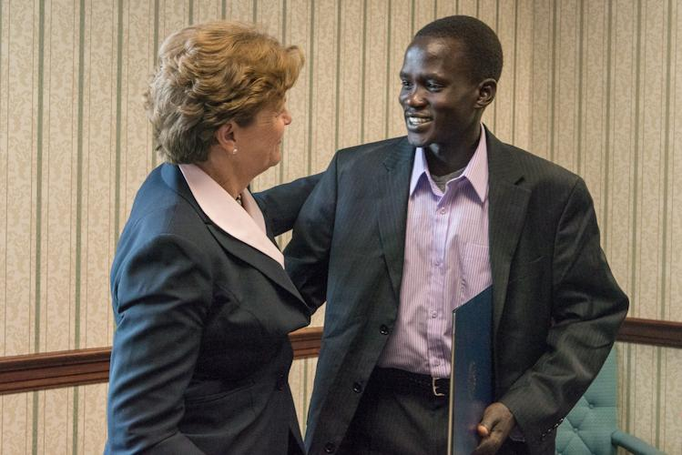 Olympian Guor Marial with Senator Jeanne Shaheen in her Manchester office.