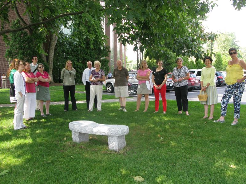 NHPR staff and volunteers gather for the volunteer bench dedication ceremony.