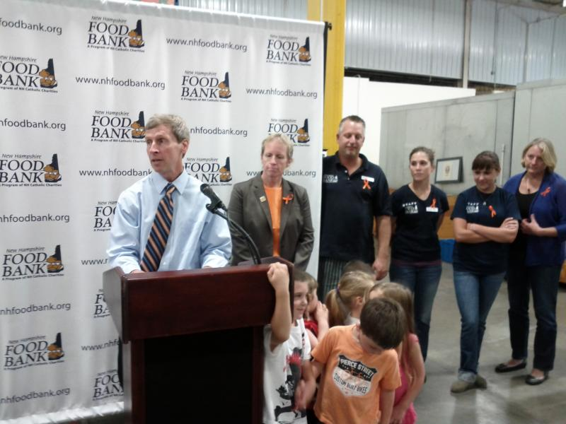 Governor John Lynch and NH Food Bank Director Mel Gosselin behind him