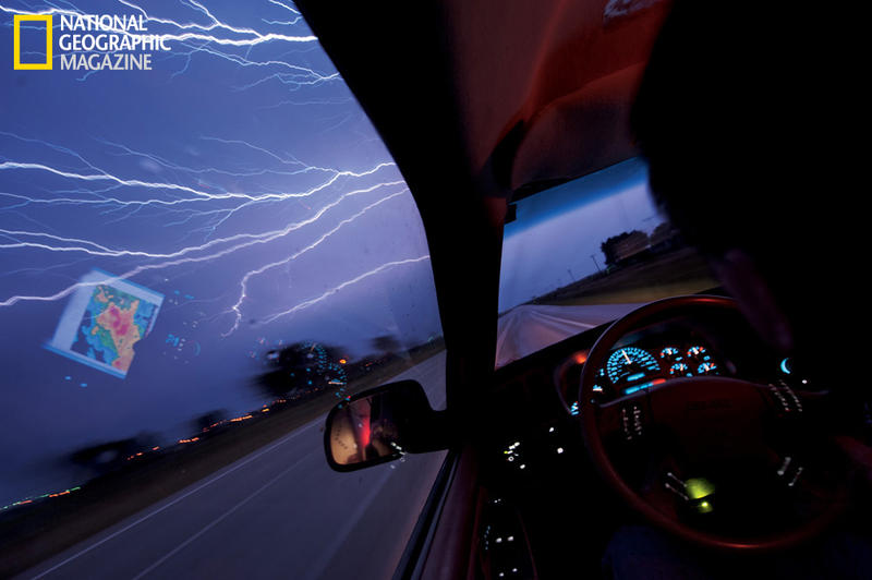 Guided by the laptop weather map reflected in his window, Tim Samaras rushes to catch up to a dying thunderstorm. He hopes to be the first to photograph the split-second event that triggers a lightning strike