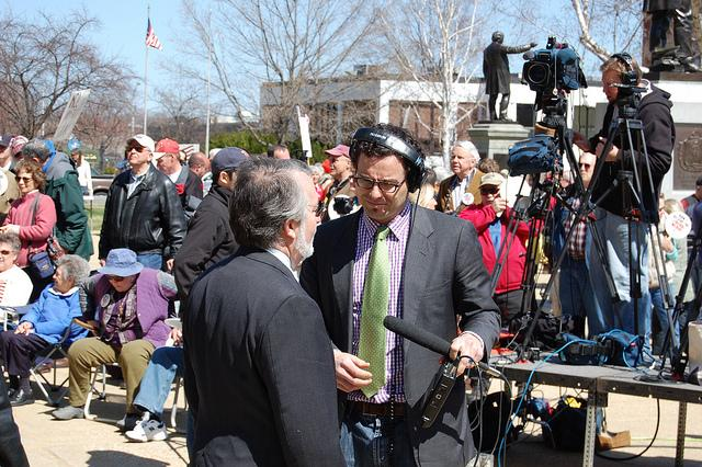 State House Speaker William O'Brien (left) talks with NHPR's Dan Gorenstein before the Taxpayer Tea Party rally in Concord, April 15, 2011.