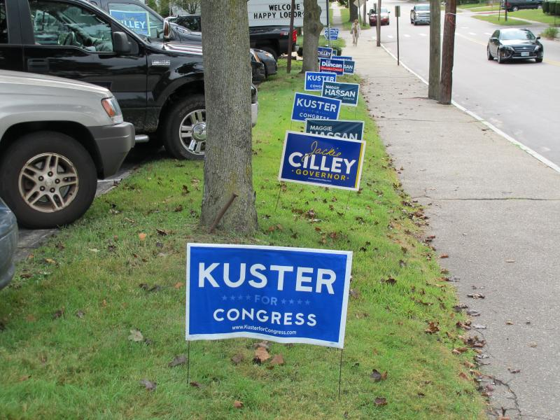Campaign signs line yard at St. George's Cathedral