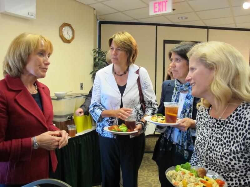 Gubernatorial candidate Maggie Hassan speaks with members of the Portsmouth Rotary Club
