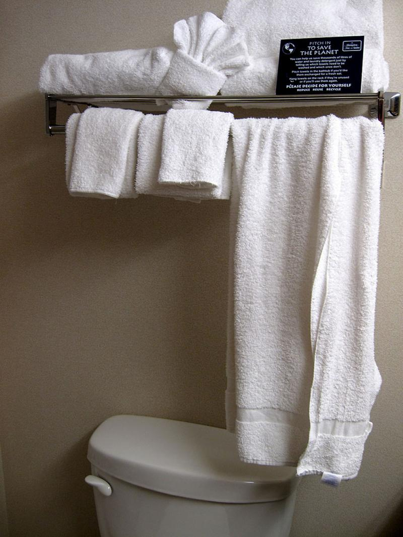 Those little cards urging you to reuse towels and linens may seem like token environmentalism, but they actually result in significant water and waste reductions.