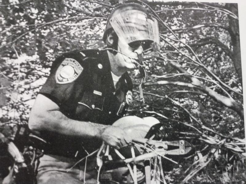 Ernie Loomis served on the State Police from 1963 to 1990, retiring with the rank of Major. He is seen here conciscating items from rioters at Hampton beech during the riots of '64.