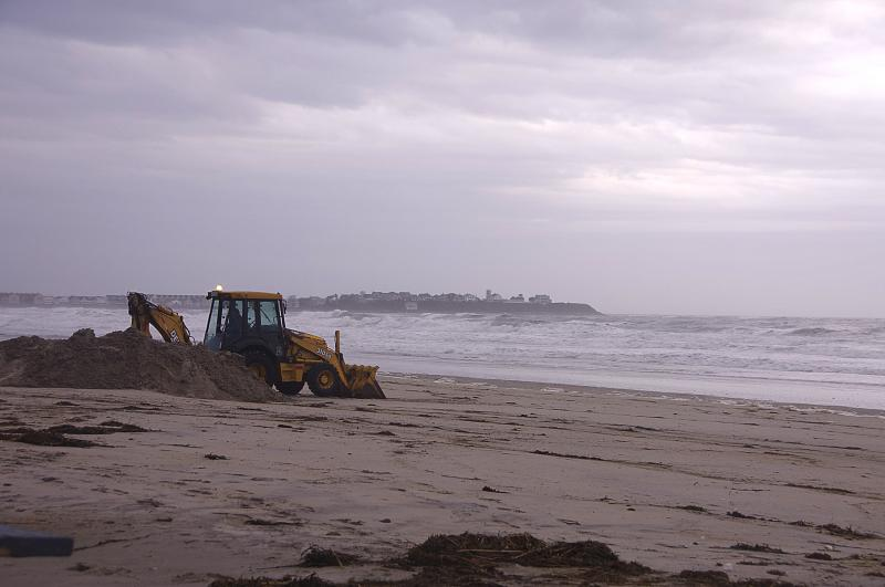Public Works employees are working to restore sand banks along Hampton Beach