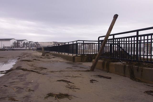 Wind gusts up to 60 mph and high surf hurled seaweed and debris onto the sidewalk on Route 1A