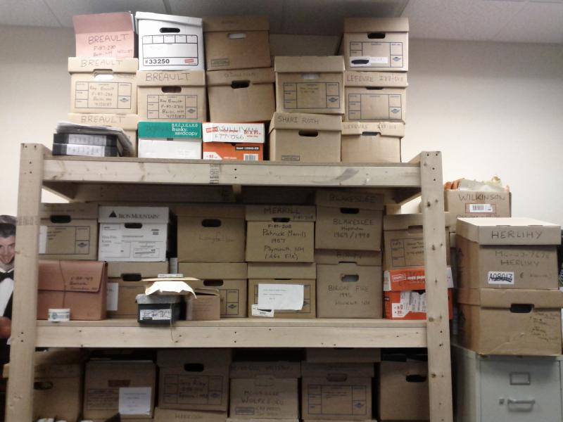 Unsolved cases stacked to the ceiling in the small office dedicated to cold case investigations.