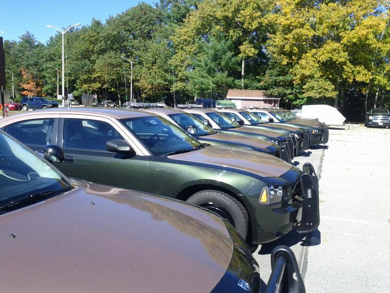 The current State Police fleet still includes some Fords but mostly consists of Dodge Chargers equipped with Project54 interface software for vocal commands and network connections to headquarters.