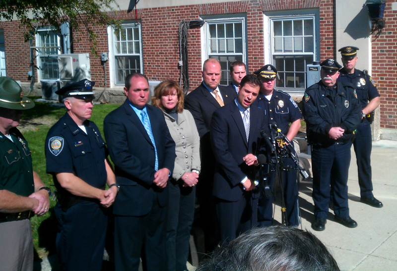 Assistant Attorney James Vara answering questions at a press conference in Dover