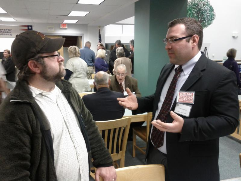 Brian Desfosses, right, talking with voter.