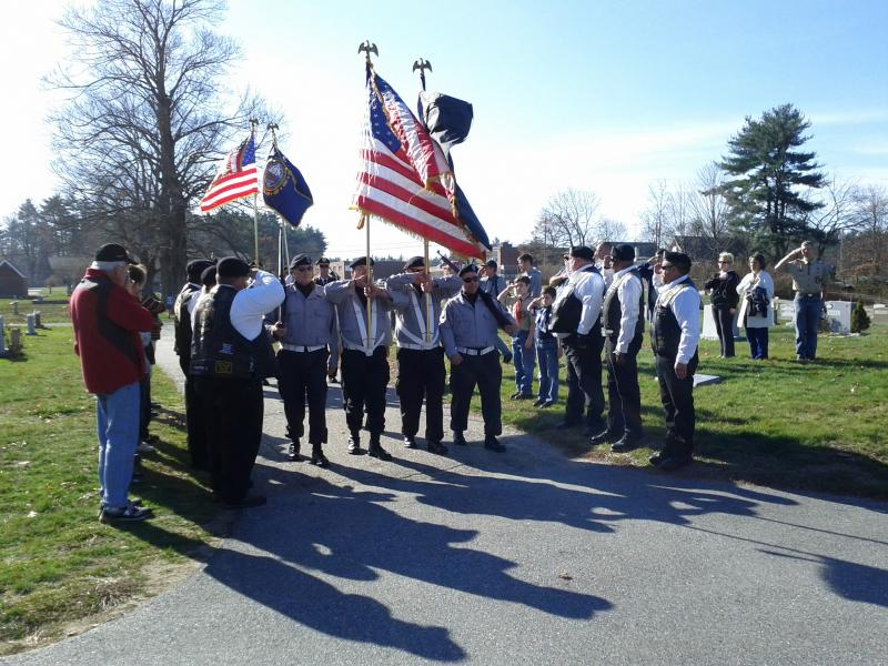 Color guard with American Legion Riders saluting