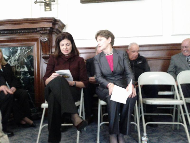 Senators Jeanne Shaheen and Kelly Ayotte seated in the VIP section.