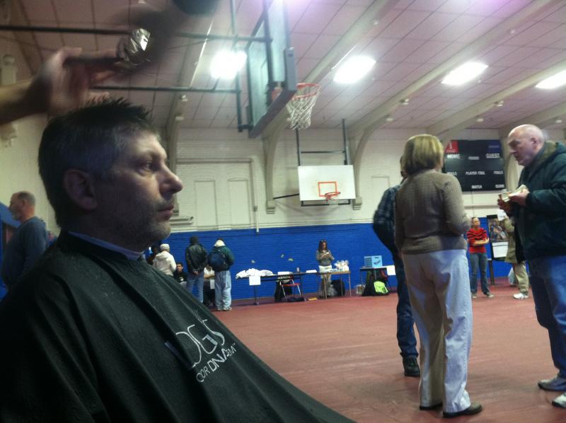 A man receives a haircut at the Project Homeless Event Wednesday.