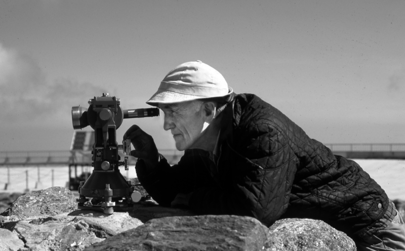 Brad Washburn using a theodolite for his mapping project on Mount Washington in 1983.