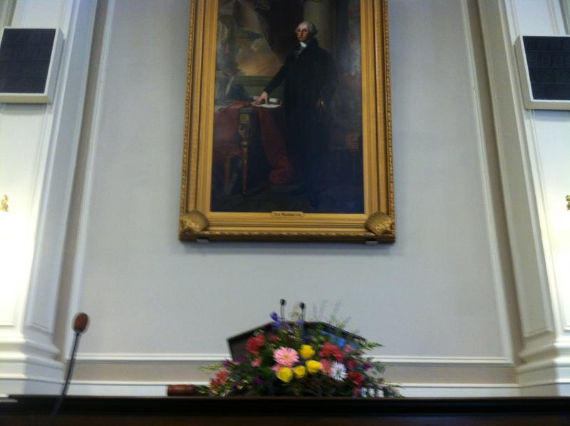 The podium in Representatives Hall at the Statehouse is ready for Gov.-elect Maggie Hassan's inauguration