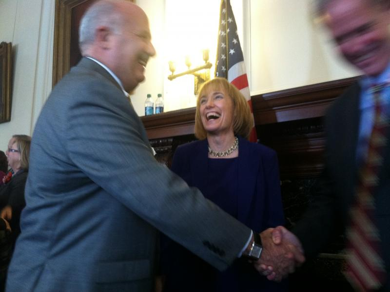 Gov. Maggie Hassan shares a laugh during the reception line following her inauguration.