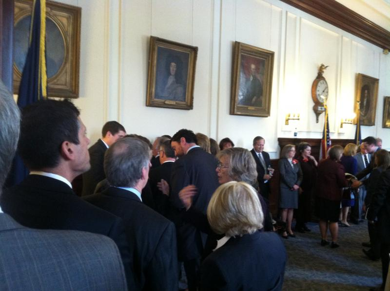The line to shake hands with New Hampshire's new governor stretched through the halls of the State House.