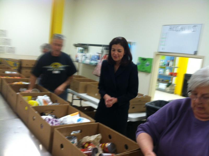 Sen. Kelly Ayotte observes during a visit to the New Hampshire Food Bank.