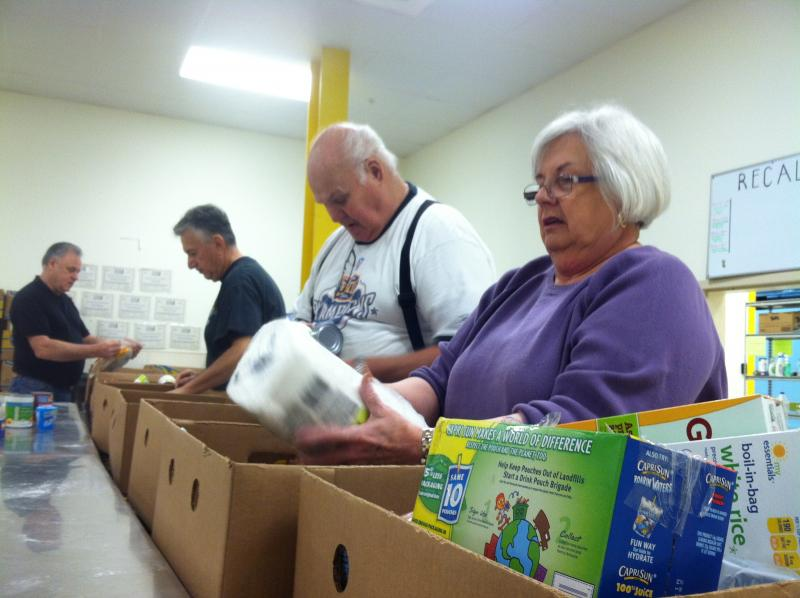 Volunteers sort through donations at the New Hampshire Food Bank.