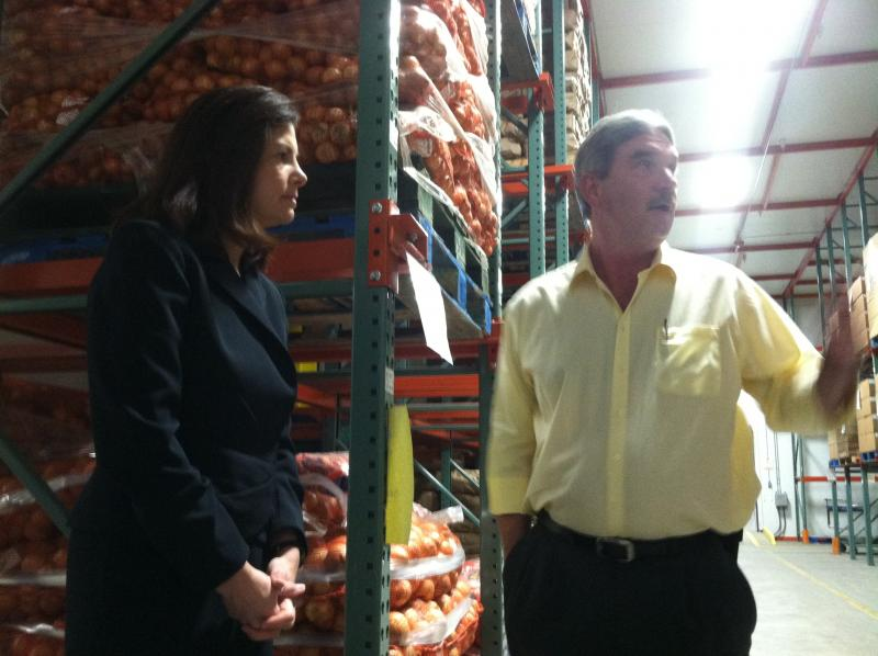 Sen. Kelly Ayotte gets a look inside the refigerated storage room during a tour of the New Hampshire Food Bank.