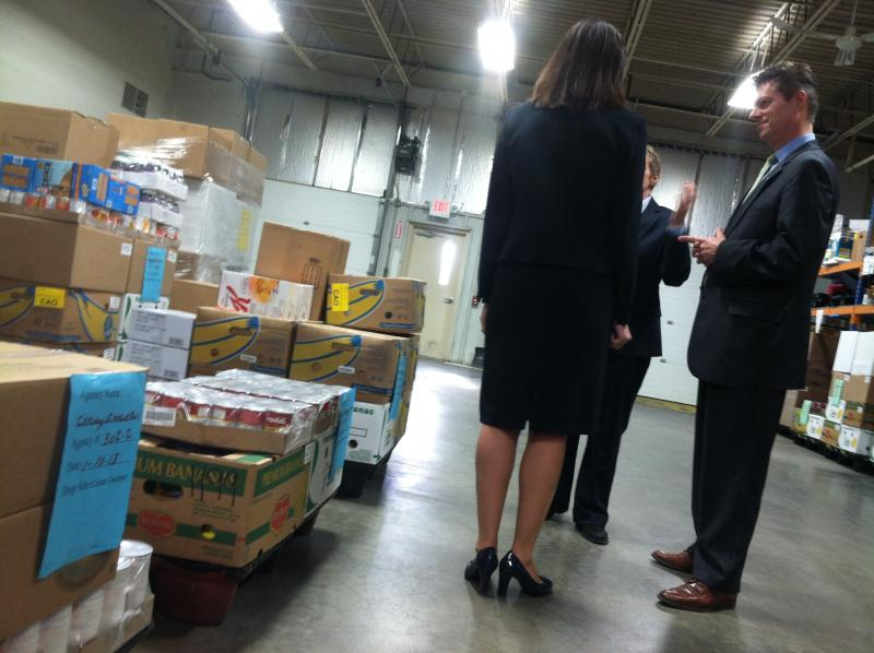 Sen. Kelly Ayotte speaks with administrators at the New Hampshire Food Bank.