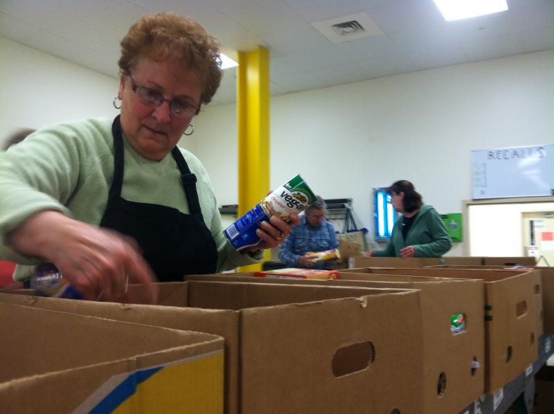 A volunteer sorts donations at the New Hampshire Food Bank.