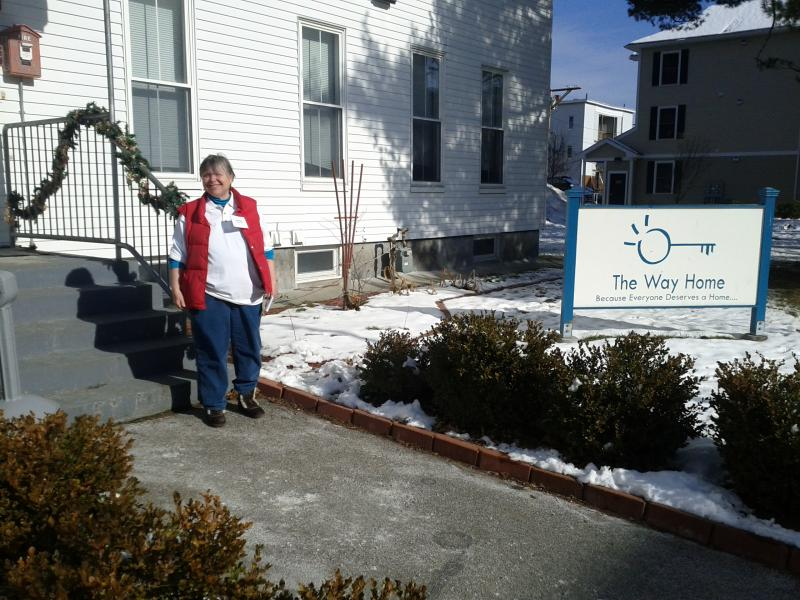Executive Director Mary Sliney at the steps to The Way Home headquarters.