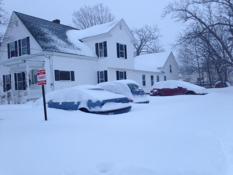 Cars were snowed under in Concord Saturday morning