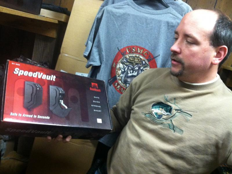 Michael Goyette, owner of Pete's Gun and Tackle in Hudson, shows the SpeedVault, a device for home gun storage.