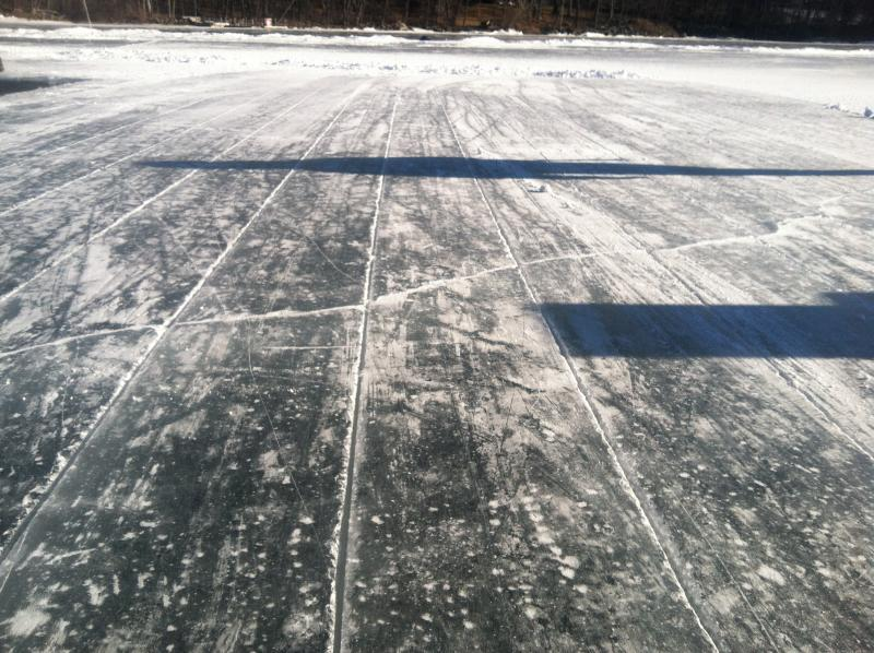 The sled saw divides the ice into one foot grid sections.