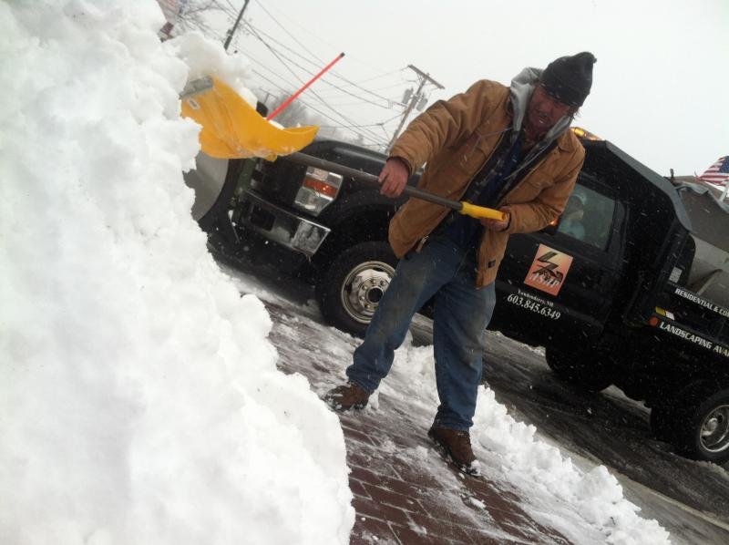 A man shovels the sidewalk in front of Rig A' Tony's in downtown Derry on Tuesday. He said he's a friend of the owner and was helping out.