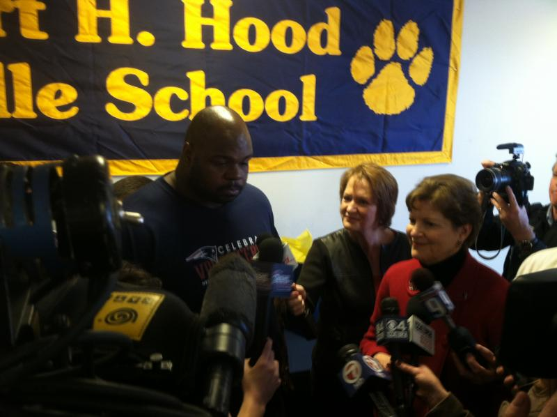 Vince Wilfork and Sen. Jeanne Shaheen answer questions from the media following a school assembly in Derry.