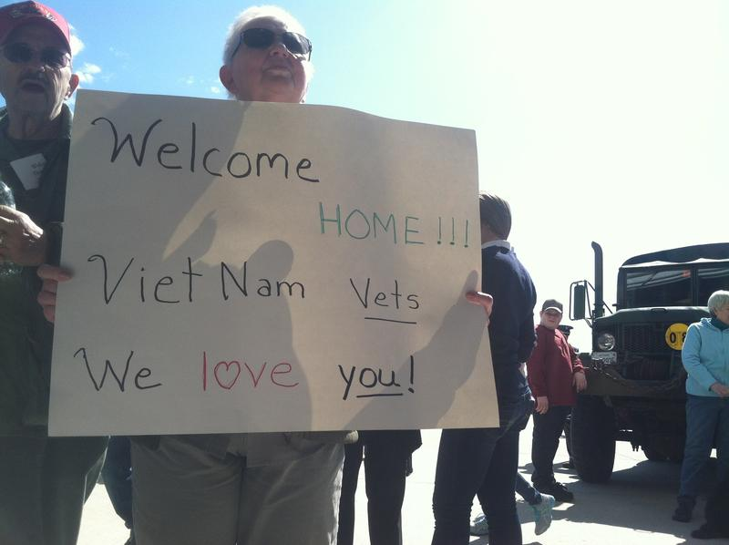 Brenda Cormier holds a sign at the Welcome Home Vietnam Veterans event in Concord Saturday. Her husband Gerald served in the war. The couple is from Dover.