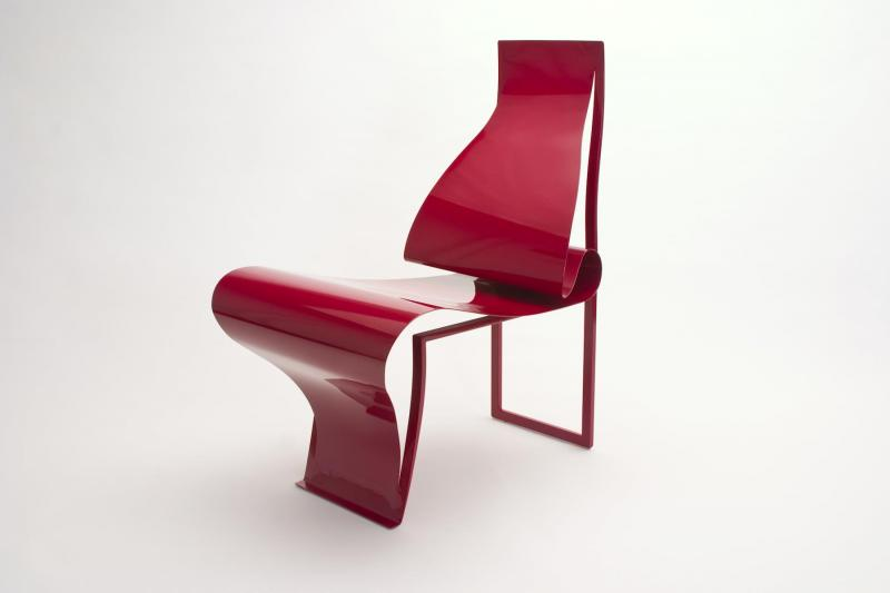 The complex curves in the steel in this chair are both what makes it alluring, and what makes it structurally strong