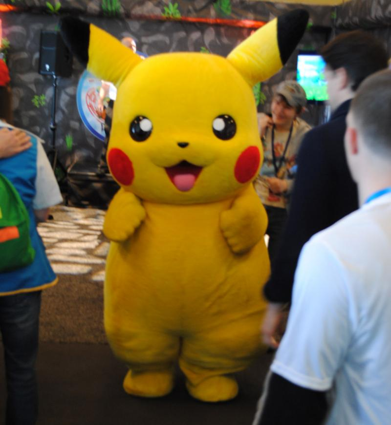 Pikachu dancing in front of one exhibit