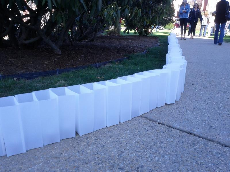 Though difficult to see with the sun out, each luminary has a blue light symbolizing child abuse awareness.